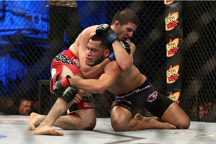 FORT CAMPBELL, KENTUCKY - NOVEMBER 6:  Rustam Khabilov (left) attempts to submit Jorge Masvidal (right) in their UFC lightweight bout on November 6, 2013 in Fort Campbell, Kentucky. (Photo by Ed Mulholland/Zuffa LLC/Zuffa LLC via Getty Images) *** Local Caption ***Jorge Masvidal; Rustam Khabilov