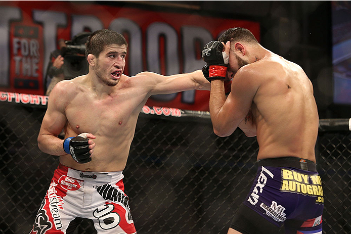 FORT CAMPBELL, KENTUCKY - NOVEMBER 6:  (L-R) Rustam Khabilov punches Jorge Masvidal in their UFC lightweight bout on November 6, 2013 in Fort Campbell, Kentucky. (Photo by Ed Mulholland/Zuffa LLC/Zuffa LLC via Getty Images) *** Local Caption ***Jorge Masvidal; Rustam Khabilov