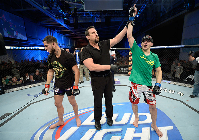 FORT CAMPBELL, KENTUCKY - NOVEMBER 6:  Rustam Khabilov (right) is declared the winner over Jorge Masvidal (left) in their UFC lightweight bout on November 6, 2013 in Fort Campbell, Kentucky. (Photo by Jeff Bottari/Zuffa LLC/Zuffa LLC via Getty Images) *** Local Caption ***Jorge Masvidal; Rustam Khabilov