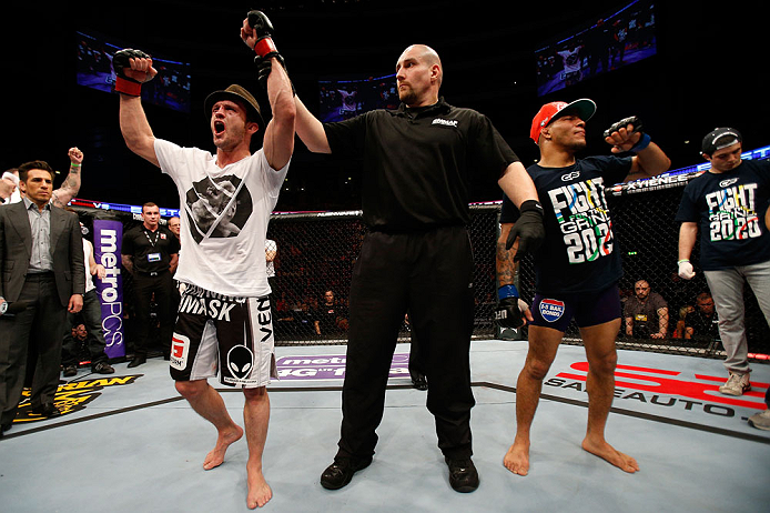 STOCKHOLM, SWEDEN - APRIL 06:  Brad Pickett (L) reacts after defeating Mike Easton in their bantamweight fight at the Ericsson Globe Arena on April 6, 2013 in Stockholm, Sweden.  (Photo by Josh Hedges/Zuffa LLC/Zuffa LLC via Getty Images)