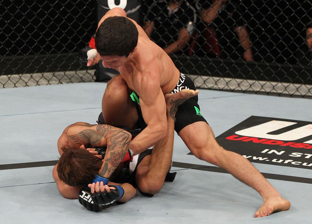 SYDNEY, AUSTRALIA - MARCH 03:  (R-L) Joseph Benavidez defeats Yasuhiro Urushitani by TKO due to punches in a flyweight bout during the UFC on FX event at Allphones Arena on March 3, 2012 in Sydney, Australia.  (Photo by Josh Hedges/Zuffa LLC/Zuffa LLC via Getty Images) *** Local Caption *** Joseph Benavidez; Yasuhiro Urushitani