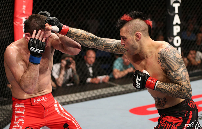 NOTTINGHAM, ENGLAND - SEPTEMBER 29:  (R-L) Dan Hardy punches Amir Sadollah during their welterweight fight at the UFC on Fuel TV event at Capital FM Arena on September 29, 2012 in Nottingham, England.  (Photo by Josh Hedges/Zuffa LLC/Zuffa LLC via Getty Images)