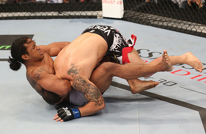 DENVER, CO - AUGUST 11:  (R-L) Benson Henderson attempts a guillotine choke submission against Frankie Edgar during their lightweight championship bout at UFC 150 inside Pepsi Center on August 11, 2012 in Denver, Colorado. (Photo by Nick Laham/Zuffa LLC/Zuffa LLC via Getty Images)