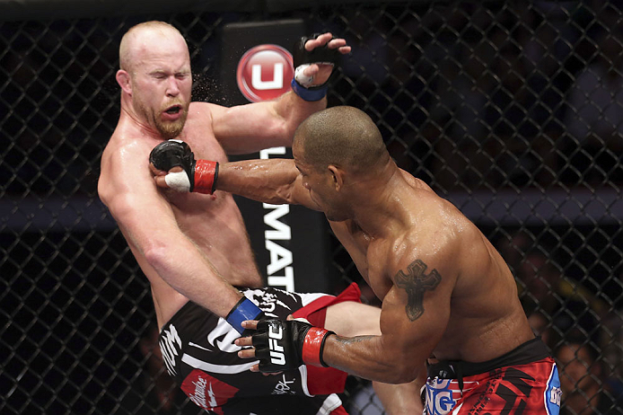 CALGARY, CANADA - JULY 21: (R-L) Hector Lombard lands a punch to the face of Tim Boetsch during their middleweight bout at UFC 149 inside the Scotiabank Saddledome on July 21, 2012 in Calgary, Alberta, Canada.  (Photo by Nick Laham/Zuffa LLC/Zuffa LLC via Getty Images)