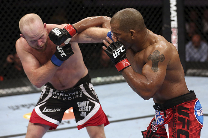 CALGARY, CANADA - JULY 21: (R-L) Hector Lombard throws a punch at Tim Boetsch during their middleweight bout at UFC 149 inside the Scotiabank Saddledome on July 21, 2012 in Calgary, Alberta, Canada.  (Photo by Nick Laham/Zuffa LLC/Zuffa LLC via Getty Images)