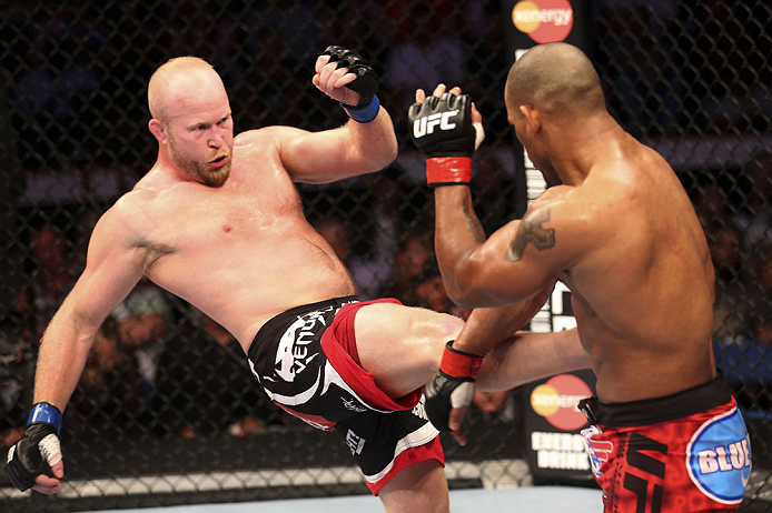 CALGARY, CANADA - JULY 21: (L-R) Tim Boetsch lands a kick to the body of Hector Lombard during their middleweight bout at UFC 149 inside the Scotiabank Saddledome on July 21, 2012 in Calgary, Alberta, Canada.  (Photo by Nick Laham/Zuffa LLC/Zuffa LLC via Getty Images)