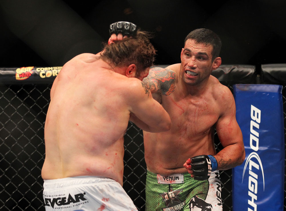 LAS VEGAS, NV - FEBRUARY 04:  Fabricio Werdum (right) punches Roy Nelson during the UFC 143 event at Mandalay Bay Events Center on February 4, 2012 in Las Vegas, Nevada.  (Photo by Josh Hedges/Zuffa LLC/Zuffa LLC via Getty Images) *** Local Caption *** Fabricio Werdum; Roy Nelson