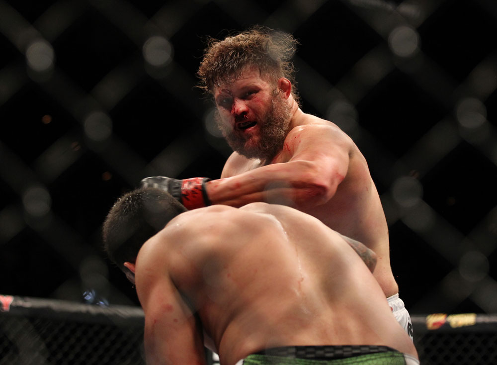 LAS VEGAS, NV - FEBRUARY 04:  Roy Nelson (pictured) punches Fabricio Werdum during the UFC 143 event at Mandalay Bay Events Center on February 4, 2012 in Las Vegas, Nevada.  (Photo by Josh Hedges/Zuffa LLC/Zuffa LLC via Getty Images) *** Local Caption *** Roy Nelson; Fabricio Werdum