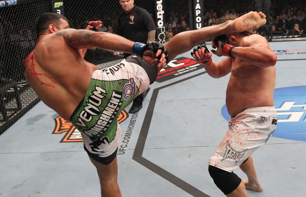 LAS VEGAS, NV - FEBRUARY 04:  Fabricio Werdum (left) headkicks Roy Nelson during the UFC 143 event at Mandalay Bay Events Center on February 4, 2012 in Las Vegas, Nevada.  (Photo by Nick Laham/Zuffa LLC/Zuffa LLC via Getty Images) *** Local Caption *** Fabricio Werdum; Roy Nelson