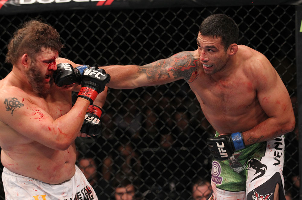 LAS VEGAS, NV - FEBRUARY 04:  (R-L) Fabricio Werdum punches Roy Nelson during the UFC 143 event at Mandalay Bay Events Center on February 4, 2012 in Las Vegas, Nevada.  (Photo by Nick Laham/Zuffa LLC/Zuffa LLC via Getty Images) *** Local Caption *** Fabricio Werdum; Roy Nelson