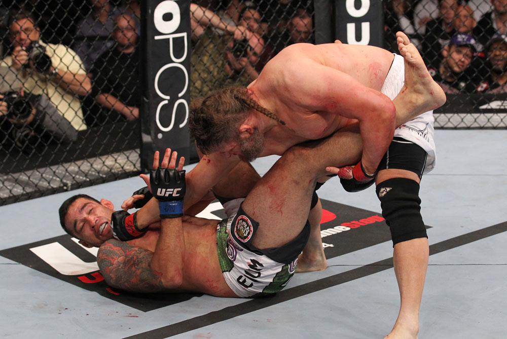 LAS VEGAS, NV - FEBRUARY 04:  Roy Nelson (right) punches Fabricio Werdum during the UFC 143 event at Mandalay Bay Events Center on February 4, 2012 in Las Vegas, Nevada.  (Photo by Nick Laham/Zuffa LLC/Zuffa LLC via Getty Images) *** Local Caption *** Roy Nelson; Fabricio Werdum