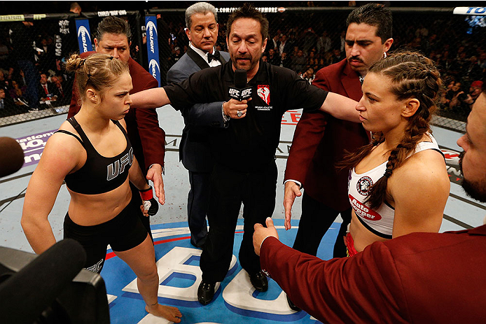 LAS VEGAS, NV - DECEMBER 28:  Ronda Rousey (left) and Miesha Tate (right) face off before their UFC women's bantamweight championship bout during the UFC 168 event at the MGM Grand Garden Arena on December 28, 2013 in Las Vegas, Nevada. (Photo by Josh Hedges/Zuffa LLC/Zuffa LLC via Getty Images) *** Local Caption *** Ronda Rousey; Miesha Tate