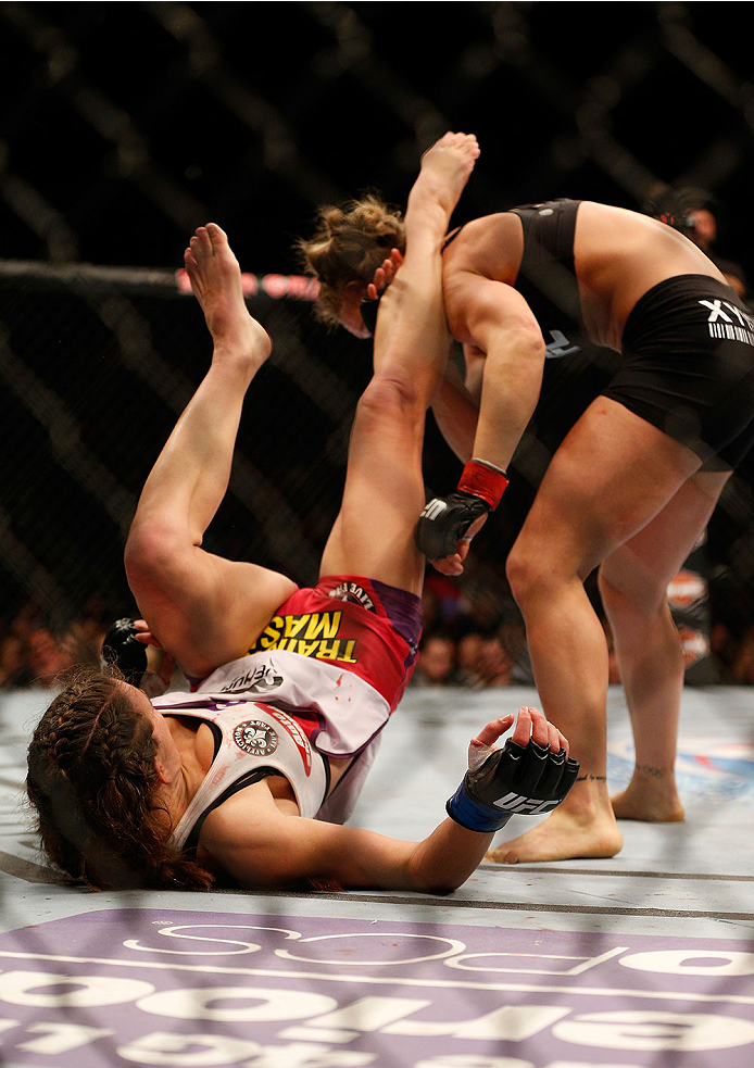 LAS VEGAS, NV - DECEMBER 28:  Miesha Tate (left) kicks Ronda Rousey in their UFC women's bantamweight championship bout during the UFC 168 event at the MGM Grand Garden Arena on December 28, 2013 in Las Vegas, Nevada. (Photo by Josh Hedges/Zuffa LLC/Zuffa LLC via Getty Images) *** Local Caption *** Ronda Rousey; Miesha Tate