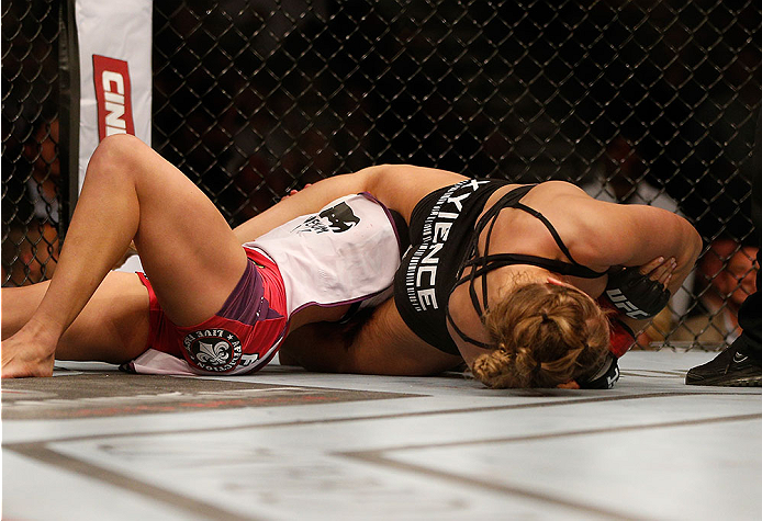LAS VEGAS, NV - DECEMBER 28:  Ronda Rousey (right) attempts to submit Miesha Tate in their UFC women's bantamweight championship bout during the UFC 168 event at the MGM Grand Garden Arena on December 28, 2013 in Las Vegas, Nevada. (Photo by Josh Hedges/Zuffa LLC/Zuffa LLC via Getty Images) *** Local Caption *** Ronda Rousey; Miesha Tate