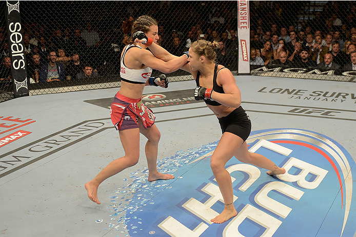 LAS VEGAS, NV - DECEMBER 28:  (L-R) Ronda Rousey punches Miesha Tate in their UFC women's bantamweight championship bout during the UFC 168 event at the MGM Grand Garden Arena on December 28, 2013 in Las Vegas, Nevada. (Photo by Donald Miralle/Zuffa LLC/Zuffa LLC via Getty Images) *** Local Caption *** Ronda Rousey; Miesha Tate