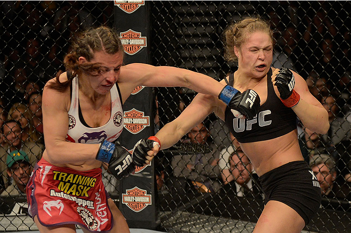 LAS VEGAS, NV - DECEMBER 28:  (L-R) Miesha Tate punches Ronda Rousey in their UFC women's bantamweight championship bout during the UFC 168 event at the MGM Grand Garden Arena on December 28, 2013 in Las Vegas, Nevada. (Photo by Donald Miralle/Zuffa LLC/Zuffa LLC via Getty Images) *** Local Caption *** Ronda Rousey; Miesha Tate