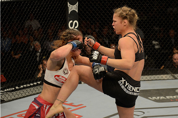 LAS VEGAS, NV - DECEMBER 28:  (R-L) Ronda Rousey knees Miesha Tate in their UFC women's bantamweight championship bout during the UFC 168 event at the MGM Grand Garden Arena on December 28, 2013 in Las Vegas, Nevada. (Photo by Donald Miralle/Zuffa LLC/Zuffa LLC via Getty Images) *** Local Caption *** Ronda Rousey; Miesha Tate