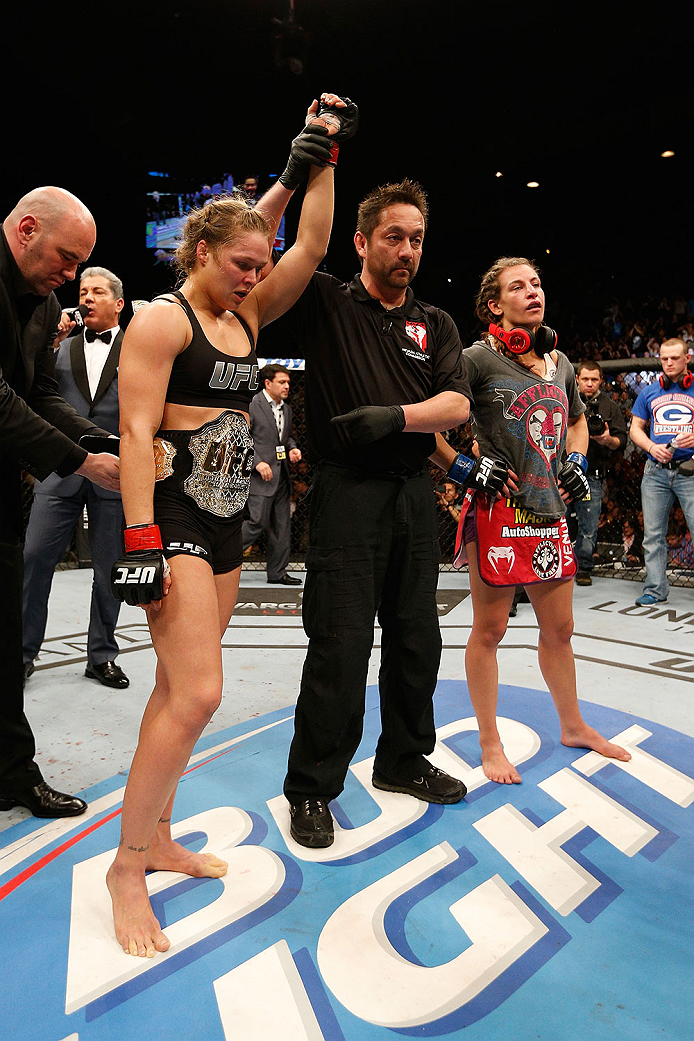 LAS VEGAS, NV - DECEMBER 28:  Ronda Rousey (left) reacts to her victory over Miesha Tate (right) in their UFC women's bantamweight championship bout during the UFC 168 event at the MGM Grand Garden Arena on December 28, 2013 in Las Vegas, Nevada. (Photo by Josh Hedges/Zuffa LLC/Zuffa LLC via Getty Images) *** Local Caption *** Ronda Rousey; Miesha Tate