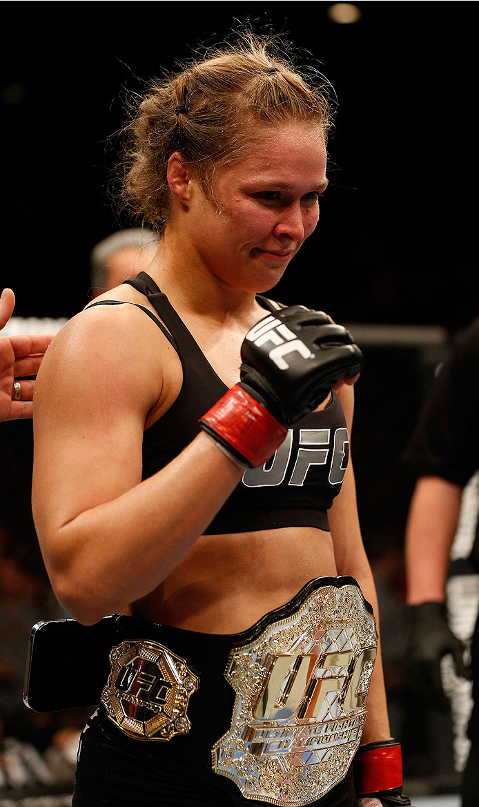 LAS VEGAS, NV - DECEMBER 28:  Ronda Rousey reacts to her victory over Miesha Tate in their UFC women's bantamweight championship bout during the UFC 168 event at the MGM Grand Garden Arena on December 28, 2013 in Las Vegas, Nevada. (Photo by Josh Hedges/Zuffa LLC/Zuffa LLC via Getty Images) *** Local Caption *** Ronda Rousey