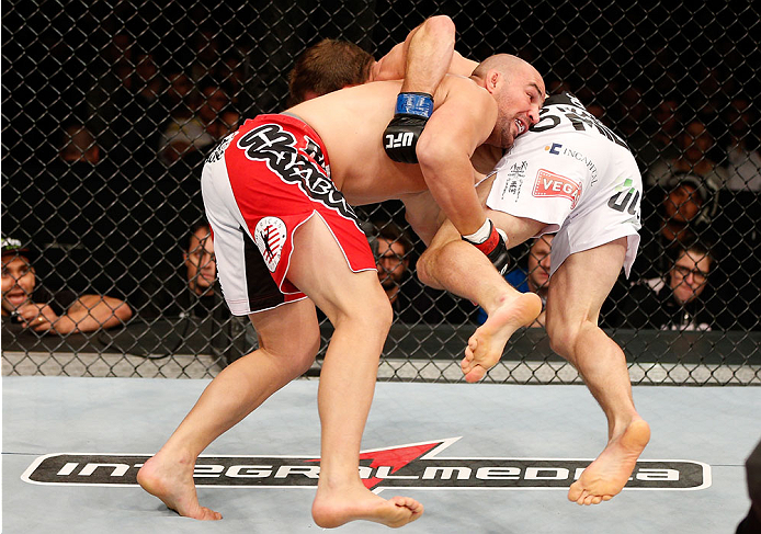 BELO HORIZONTE, BRAZIL - SEPTEMBER 04:  (L-R) Glover Teixeira takes down Ryan Bader in their light heavyweight fight during the UFC on FOX Sports 1 event at Mineirinho Arena on September 4, 2013 in Belo Horizonte, Brazil. (Photo by Josh Hedges/Zuffa LLC/Zuffa LLC via Getty Images)