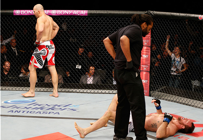 BELO HORIZONTE, BRAZIL - SEPTEMBER 04:  Glover Teixeira (L) reacts after knocking out Ryan Bader in their light heavyweight fight during the UFC on FOX Sports 1 event at Mineirinho Arena on September 4, 2013 in Belo Horizonte, Brazil. (Photo by Josh Hedges/Zuffa LLC/Zuffa LLC via Getty Images)