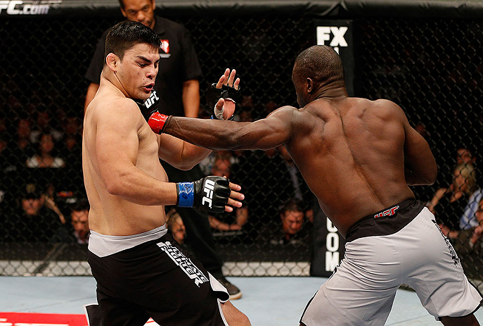 LAS VEGAS, NV - APRIL 13:   (R-L) Uriah Hall punches Kelvin Gastelum in their middleweight fight at the Mandalay Bay Events Center  on April 13, 2013 in Las Vegas, Nevada.  (Photo by Josh Hedges/Zuffa LLC/Zuffa LLC via Getty Images)  *** Local Caption *** Uriah Hall; Kelvin Gastelum