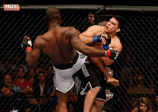 LAS VEGAS, NV - APRIL 13:   (L-R) Uriah Hall kicks Kelvin Gastelum in their middleweight fight at the Mandalay Bay Events Center  on April 13, 2013 in Las Vegas, Nevada.  (Photo by Josh Hedges/Zuffa LLC/Zuffa LLC via Getty Images)  *** Local Caption *** Uriah Hall; Kelvin Gastelum