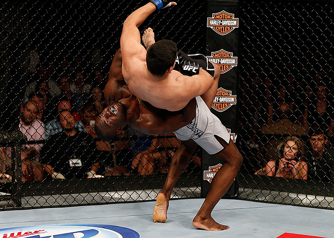 LAS VEGAS, NV - APRIL 13:   Uriah Hall (bottom) slams Kelvin Gastelum in their middleweight fight at the Mandalay Bay Events Center  on April 13, 2013 in Las Vegas, Nevada.  (Photo by Josh Hedges/Zuffa LLC/Zuffa LLC via Getty Images)  *** Local Caption *** Uriah Hall; Kelvin Gastelum