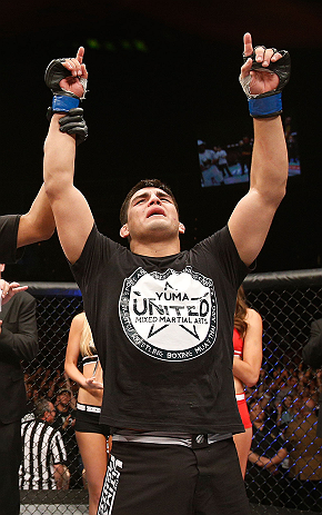 LAS VEGAS, NV - APRIL 13:   Kelvin Gastelum reacts to his victory over Uriah Hall in their middleweight fight at the Mandalay Bay Events Center  on April 13, 2013 in Las Vegas, Nevada.  (Photo by Josh Hedges/Zuffa LLC/Zuffa LLC via Getty Images)  *** Local Caption *** Uriah Hall; Kelvin Gastelum