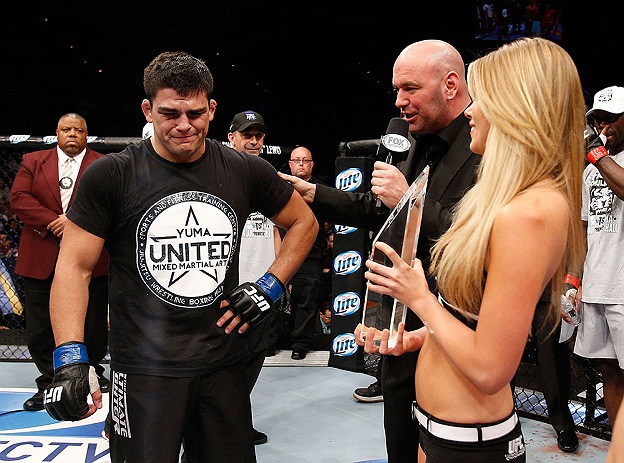 LAS VEGAS, NV - APRIL 13:   Kelvin Gastelum (left) is presented the Ultimate Fighter season 17 trophy by UFC President Dana White (right) in their middleweight fight at the Mandalay Bay Events Center  on April 13, 2013 in Las Vegas, Nevada.  (Photo by Josh Hedges/Zuffa LLC/Zuffa LLC via Getty Images)  *** Local Caption *** Uriah Hall; Kelvin Gastelum