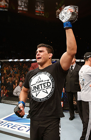 Kelvin Gastelum celebrates his victory in the TUF 17 finale