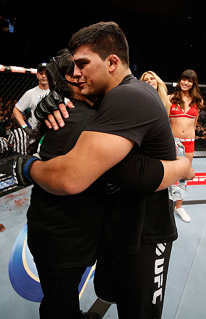 LAS VEGAS, NV - APRIL 13:   Kelvin Gastelum (right) embraces his mother after his middleweight fight at the Mandalay Bay Events Center  on April 13, 2013 in Las Vegas, Nevada.  (Photo by Josh Hedges/Zuffa LLC/Zuffa LLC via Getty Images)  *** Local Caption *** Uriah Hall; Kelvin Gastelum