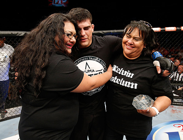 LAS VEGAS, NV - APRIL 13:   Kelvin Gastelum (center) embraces his family after his middleweight fight at the Mandalay Bay Events Center  on April 13, 2013 in Las Vegas, Nevada.  (Photo by Josh Hedges/Zuffa LLC/Zuffa LLC via Getty Images)  *** Local Caption *** Uriah Hall; Kelvin Gastelum