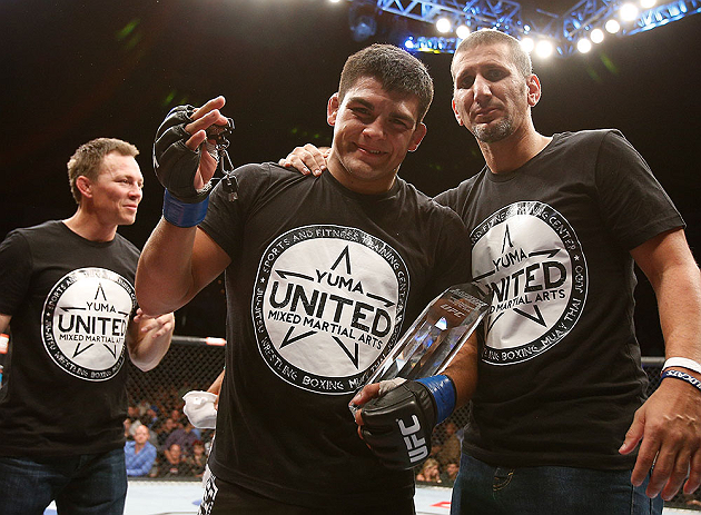 LAS VEGAS, NV - APRIL 13:   Kelvin Gastelum (center) with the Ultimate Fighter season 17 trophy in their middleweight fight at the Mandalay Bay Events Center  on April 13, 2013 in Las Vegas, Nevada.  (Photo by Josh Hedges/Zuffa LLC/Zuffa LLC via Getty Images)  *** Local Caption *** Uriah Hall; Kelvin Gastelum