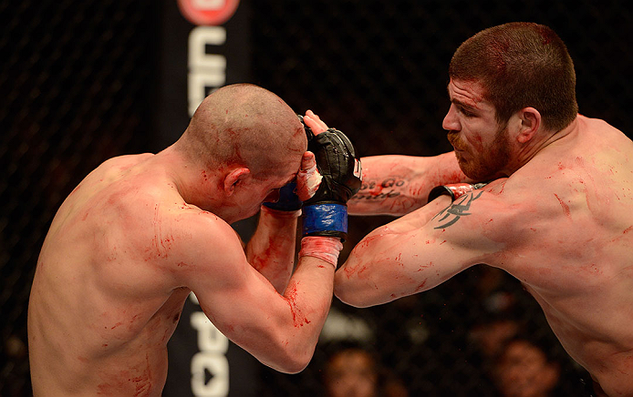 LAS VEGAS, NV - DECEMBER 29:  (R-L) Jim Miller elbows Joe Lauzon during their lightweight fight at UFC 155 on December 29, 2012 at MGM Grand Garden Arena in Las Vegas, Nevada. (Photo by Donald Miralle/Zuffa LLC/Zuffa LLC via Getty Images) *** Local Caption *** Joe Lauzon; Jim Miller