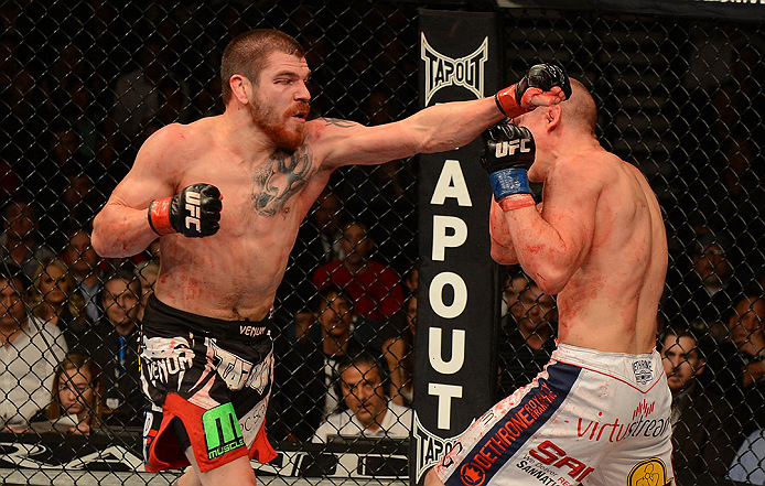 LAS VEGAS, NV - DECEMBER 29:  (L-R) Jim Miller punches Joe Lauzon during their lightweight fight at UFC 155 on December 29, 2012 at MGM Grand Garden Arena in Las Vegas, Nevada. (Photo by Donald Miralle/Zuffa LLC/Zuffa LLC via Getty Images) *** Local Caption *** Joe Lauzon; Jim Miller