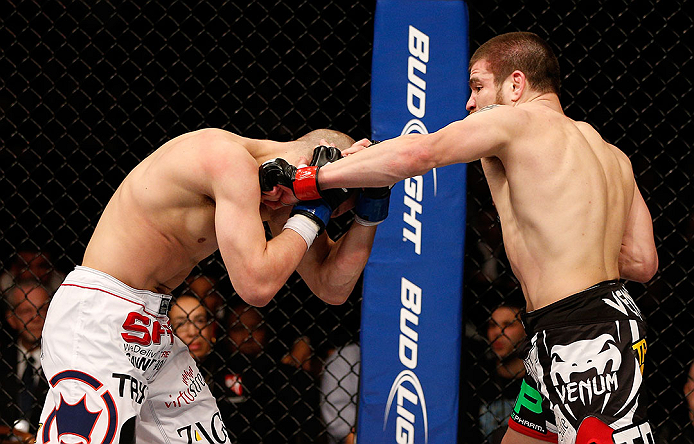 LAS VEGAS, NV - DECEMBER 29:  (R-L) Jim Miller punches Joe Lauzon during their lightweight fight at UFC 155 on December 29, 2012 at MGM Grand Garden Arena in Las Vegas, Nevada. (Photo by Josh Hedges/Zuffa LLC/Zuffa LLC via Getty Images) *** Local Caption *** Joe Lauzon; Jim Miller