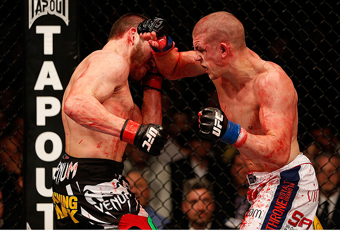 LAS VEGAS, NV - DECEMBER 29:  (R-L) Joe Lauzon punches Jim Miller during their lightweight fight at UFC 155 on December 29, 2012 at MGM Grand Garden Arena in Las Vegas, Nevada. (Photo by Josh Hedges/Zuffa LLC/Zuffa LLC via Getty Images) *** Local Caption *** Joe Lauzon; Jim Miller