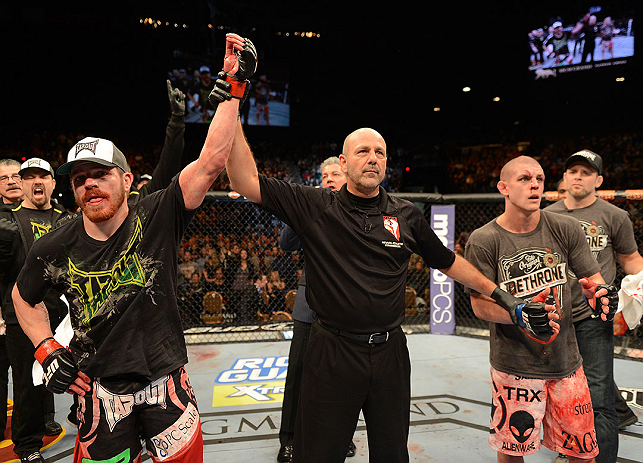 LAS VEGAS, NV - DECEMBER 29:  Jim Miller (left) reacts to being declared the winner over Joe Lauzon (right) after their lightweight fight at UFC 155 on December 29, 2012 at MGM Grand Garden Arena in Las Vegas, Nevada. (Photo by Donald Miralle/Zuffa LLC/Zuffa LLC via Getty Images) *** Local Caption *** Joe Lauzon; Jim Miller