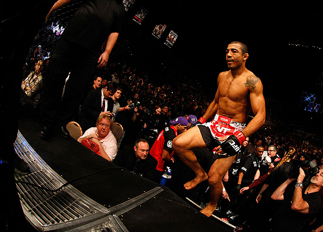 LAS VEGAS, NV - FEBRUARY 02:  Jose Aldo enters the Octagon to face Frankie Edgar before their featherweight title fight at UFC 156 on February 2, 2013 at the Mandalay Bay Events Center in Las Vegas, Nevada.  (Photo by Josh Hedges/Zuffa LLC/Zuffa LLC via Getty Images) *** Local Caption *** Jose Aldo; Frankie Edgar