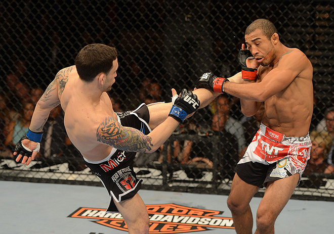 LAS VEGAS, NV - FEBRUARY 02:  (L-R) Frankie Edgar kicks Jose Aldo during their featherweight title fight at UFC 156 on February 2, 2013 at the Mandalay Bay Events Center in Las Vegas, Nevada.  (Photo by Donald Miralle/Zuffa LLC/Zuffa LLC via Getty Images) *** Local Caption *** Jose Aldo; Frankie Edgar