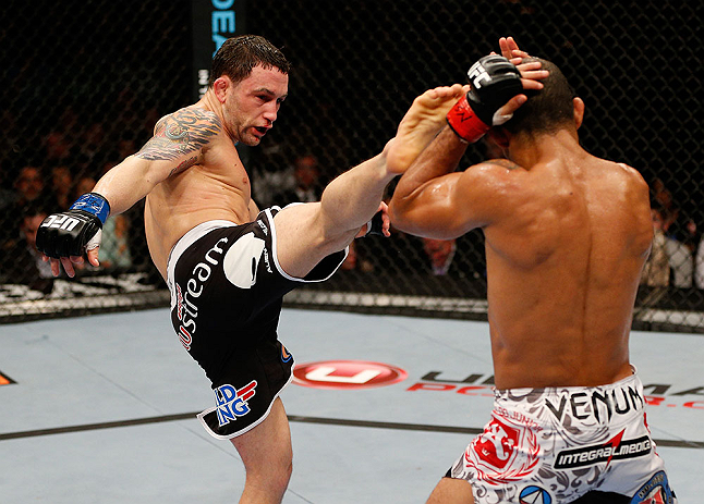 LAS VEGAS, NV - FEBRUARY 02:  (L-R) Frankie Edgar kicks Jose Aldo during their featherweight title fight at UFC 156 on February 2, 2013 at the Mandalay Bay Events Center in Las Vegas, Nevada.  (Photo by Josh Hedges/Zuffa LLC/Zuffa LLC via Getty Images) *** Local Caption *** Jose Aldo; Frankie Edgar