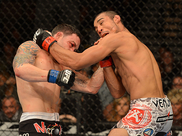LAS VEGAS, NV - FEBRUARY 02:  (L-R) Frankie Edgar punches Jose Aldo during their featherweight title fight at UFC 156 on February 2, 2013 at the Mandalay Bay Events Center in Las Vegas, Nevada.  (Photo by Donald Miralle/Zuffa LLC/Zuffa LLC via Getty Images) *** Local Caption *** Jose Aldo; Frankie Edgar