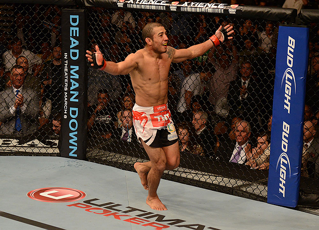LAS VEGAS, NV - FEBRUARY 02:  Jose Aldo reacts to his victory over Frankie Edgar after their featherweight title fight at UFC 156 on February 2, 2013 at the Mandalay Bay Events Center in Las Vegas, Nevada.  (Photo by Donald Miralle/Zuffa LLC/Zuffa LLC via Getty Images) *** Local Caption *** Jose Aldo; Frankie Edgar