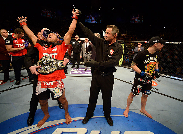 LAS VEGAS, NV - FEBRUARY 02:  Jose Aldo (left) reacts to his victory over Frankie Edgar (right) after their featherweight title fight at UFC 156 on February 2, 2013 at the Mandalay Bay Events Center in Las Vegas, Nevada.  (Photo by Josh Hedges/Zuffa LLC/Zuffa LLC via Getty Images) *** Local Caption *** Jose Aldo; Frankie Edgar