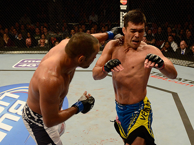 ANAHEIM, CA - FEBRUARY 23:  (L-R) Dan Henderson punches Lyoto Machida in their light heavyweight bout during UFC 157 at Honda Center on February 23, 2013 in Anaheim, California.  (Photo by Donald Miralle/Zuffa LLC/Zuffa LLC via Getty Images) *** Local Caption *** Lyoto Machida; Dan Henderson