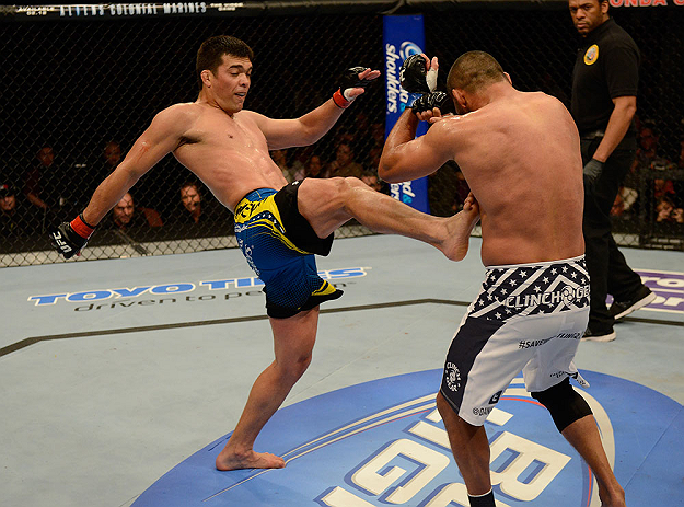 ANAHEIM, CA - FEBRUARY 23:  (L-R) Lyoto Machida kicks Dan Henderson in their light heavyweight bout during UFC 157 at Honda Center on February 23, 2013 in Anaheim, California.  (Photo by Donald Miralle/Zuffa LLC/Zuffa LLC via Getty Images) *** Local Caption *** Lyoto Machida; Dan Henderson