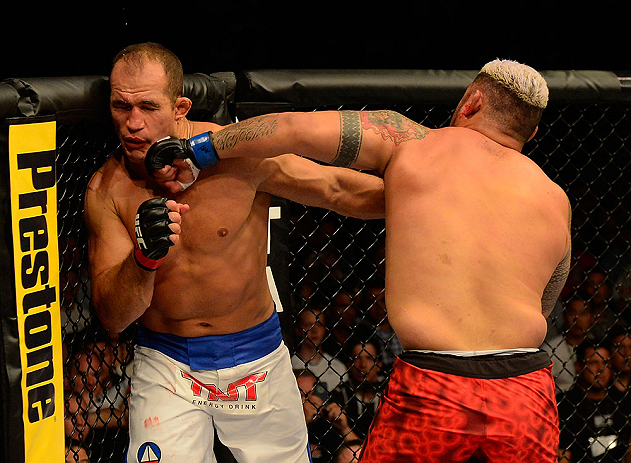 LAS VEGAS, NV - MAY 25:   (R-L) Mark Hunt punches Junior dos Santos in their heavyweight bout during UFC 160 at the MGM Grand Garden Arena on May 25, 2013 in Las Vegas, Nevada.  (Photo by Donald Miralle/Zuffa LLC/Zuffa LLC via Getty Images)  *** Local Caption *** Junior dos Santos; Mark Hunt