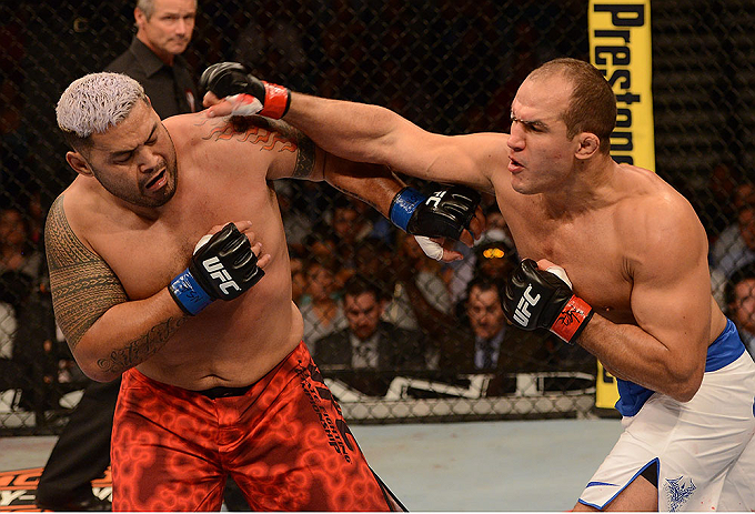 LAS VEGAS, NV - MAY 25:   (R-L) Junior dos Santos punches Mark Hunt in their heavyweight bout during UFC 160 at the MGM Grand Garden Arena on May 25, 2013 in Las Vegas, Nevada.  (Photo by Donald Miralle/Zuffa LLC/Zuffa LLC via Getty Images)  *** Local Caption *** Junior dos Santos; Mark Hunt