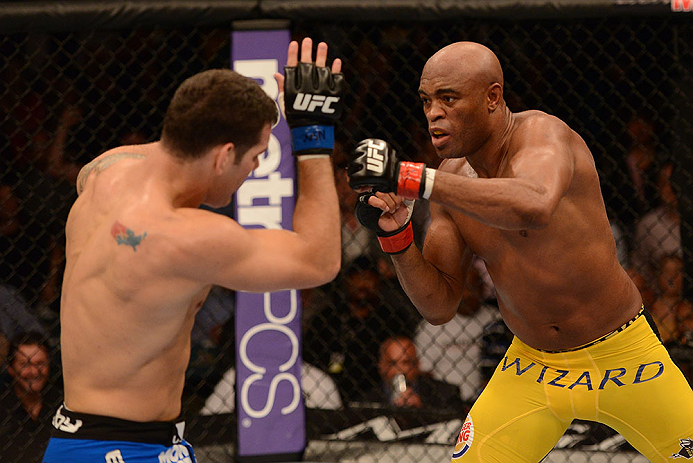 LAS VEGAS, NV - JULY 06:  (R-L) Anderson Silva punches Chris Weidman in their UFC middleweight championship fight during the UFC 162 event inside the MGM Grand Garden Arena on July 6, 2013 in Las Vegas, Nevada.  (Photo by Donald Miralle/Zuffa LLC/Zuffa LLC via Getty Images) *** Local Caption *** Anderson Silva; Chris Weidman